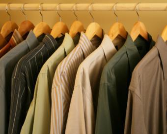 Nine men's shirts hanging in a closet