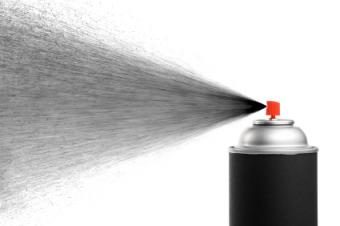Spray can spraying black paint