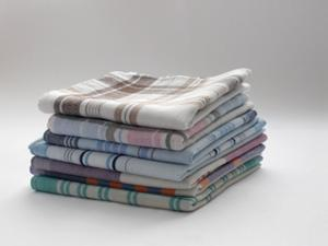 Photo of a stack of vintage handkerchiefs
