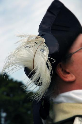 https://cf.ltkcdn.net/mens-fashion/images/slide/48999-565x850-Feather-in-hat.jpg
