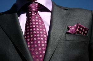man's jacket and tie