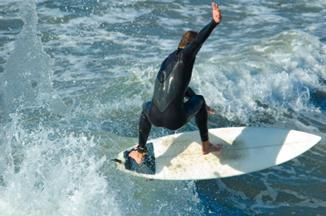 Daredevil surfer wearing a wetsuit