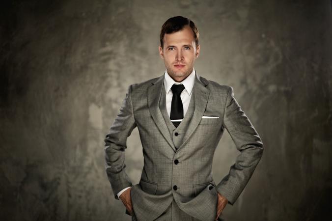 Man wearing three piece suit