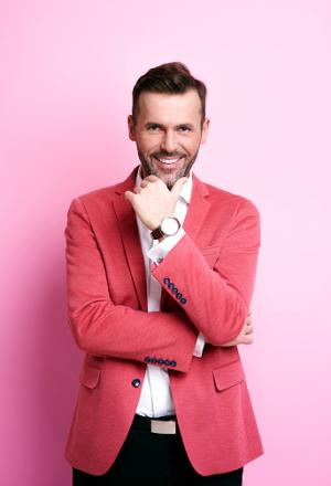 man wearing pink jacket