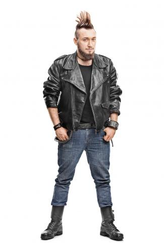 Punk man in a leather jacket, jeans and boots