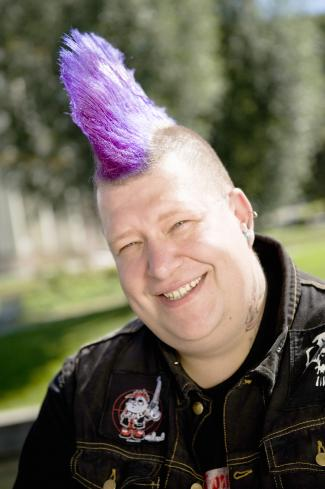 Big man with purple mohawk and punk jacket