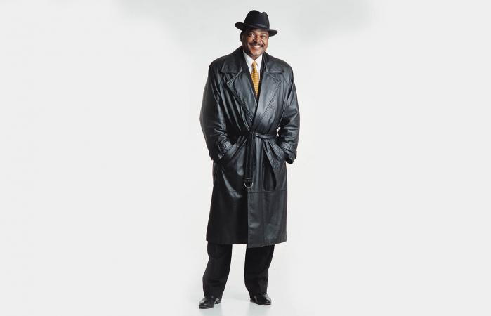 Man in a full-length leather trench coat