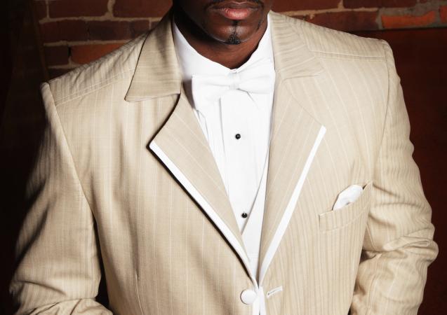 Man in a tan tuxedo suit