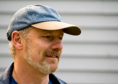 Man wearing a denim baseball cap