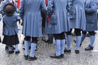 Men in period costumes with leggings