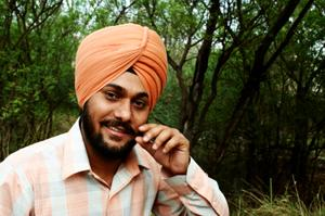 Sikh man wearing traditional orange turban