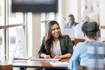Woman applies for bank loan