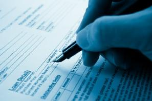 Filling out mortgage refinance application