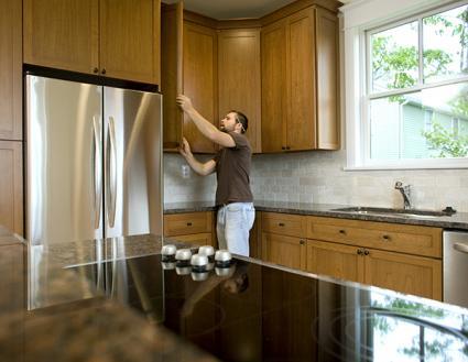 Man working on kitchen cabinets