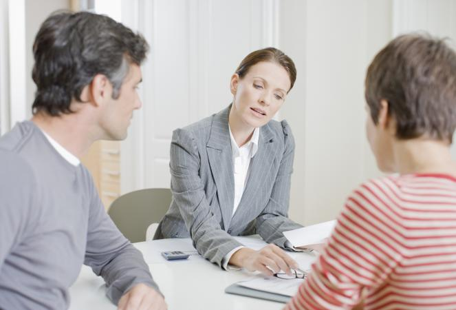 Couple meeting with mortgage originator