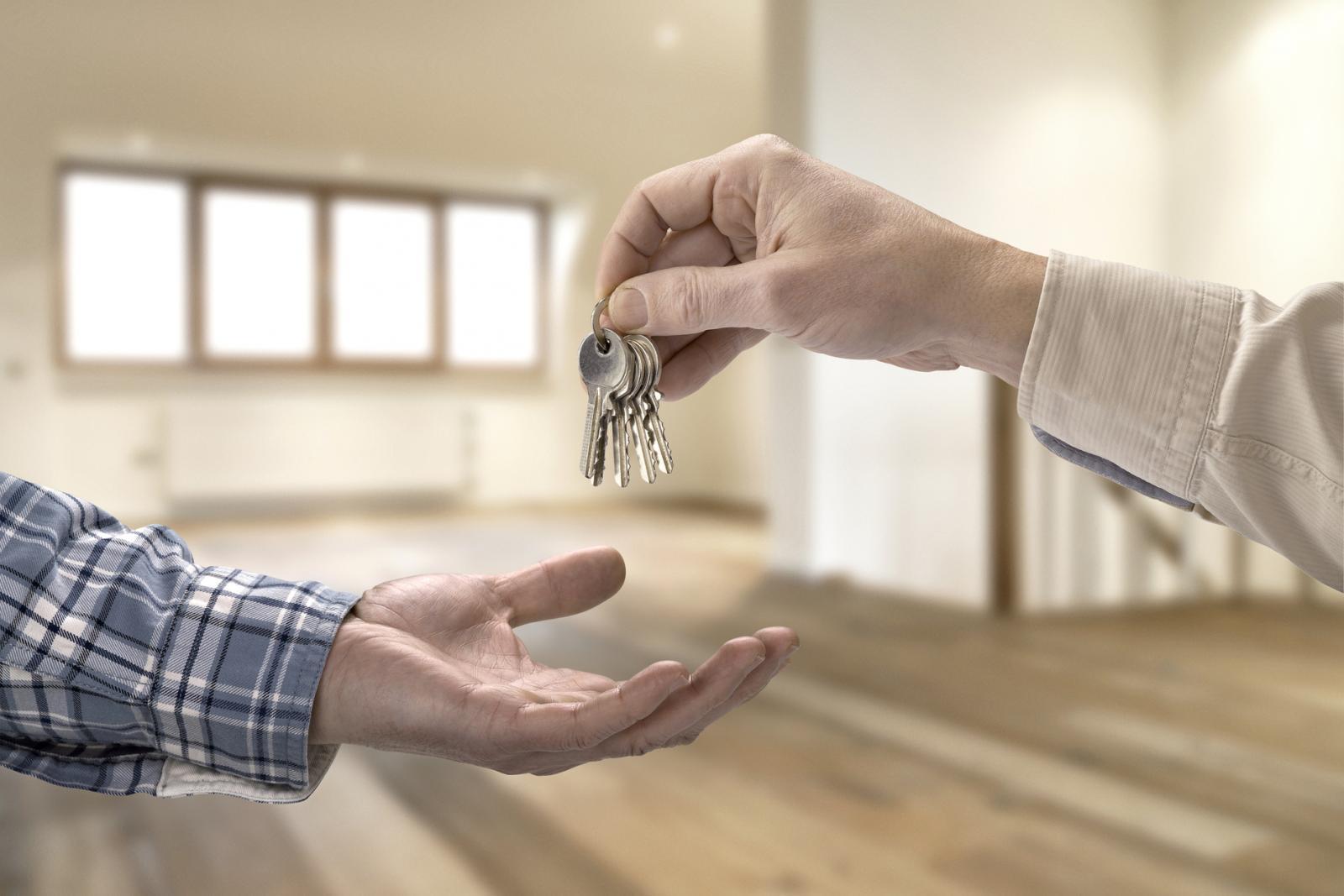 Realtor giving house key