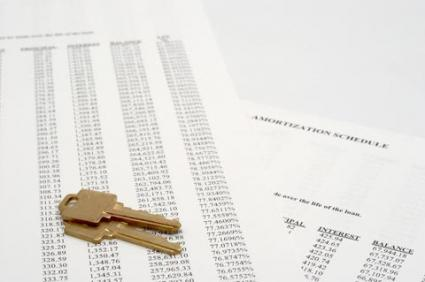 Image of amortization tables and house keys