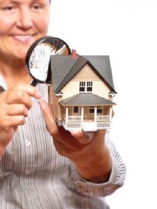 Woman inspecting house.