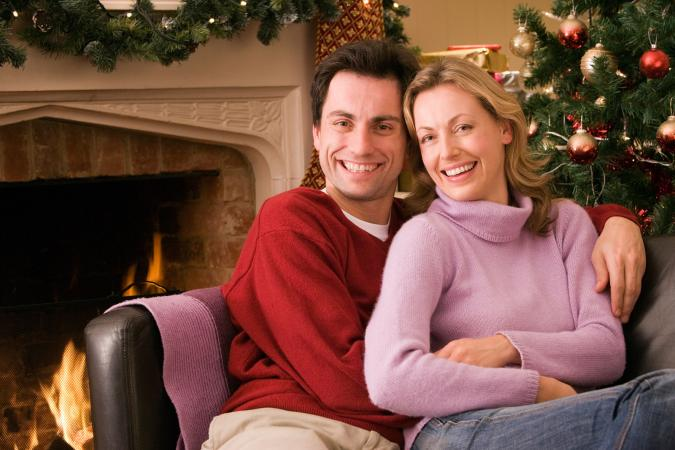 Couple enjoying watching a Christmas movie