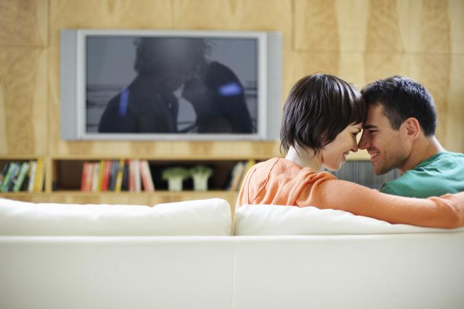 Intimate couple watching romantic movie