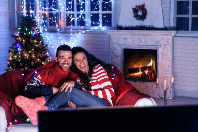 Couple watching Christmas comedy movie