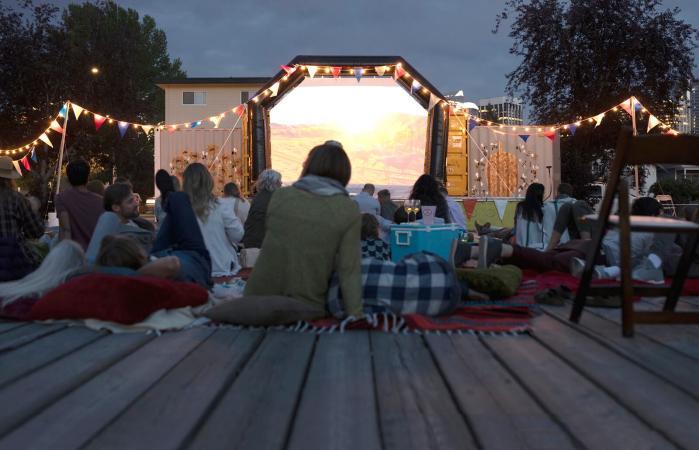 Crowd enjoying movie in the park