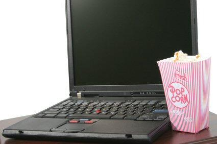 Woman Watching Movie on Computer
