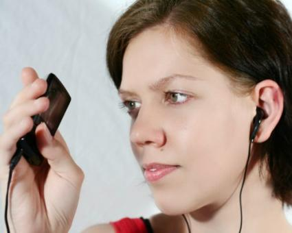 Girl holding an MP3 player