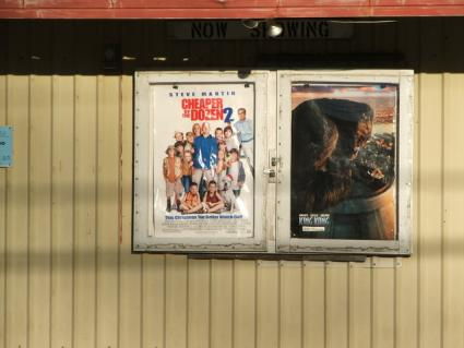 Movie posters outside a theatre