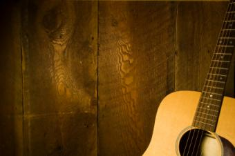 Acoustic guitar on wood wall