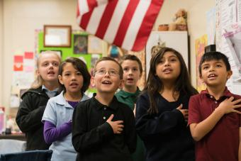 Students standing for Pledge of Allegiance