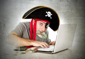 man downloading music and movies