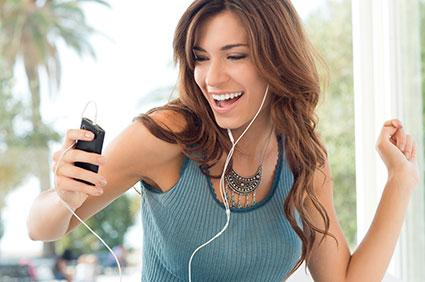 Woman listening to pop music.