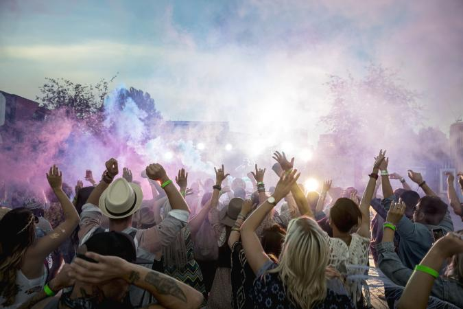 Color smoke over outdoor music festival