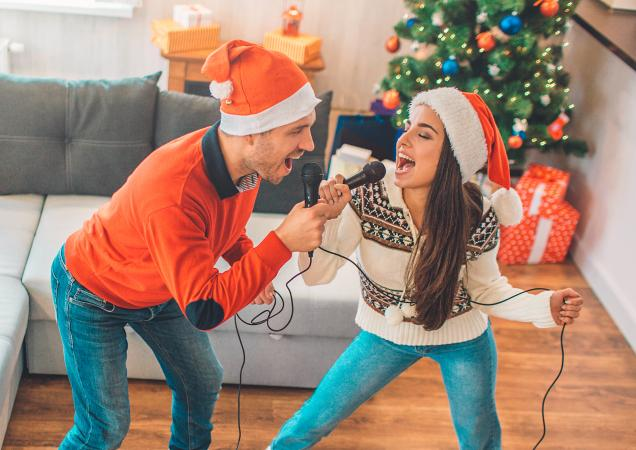 Couple singing together at Christmas