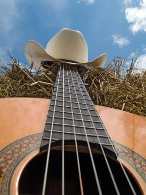 Acoustic guitar with cowboy hat