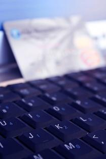 Laptop keyboard with credit card for shopping online
