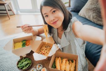 Woman Taking Selfie While Eating Takeaway Food