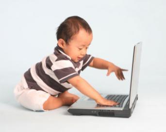 Toddler Using a Laptop