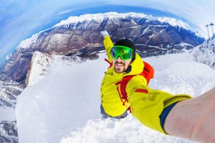Taking selfie on top of mountain