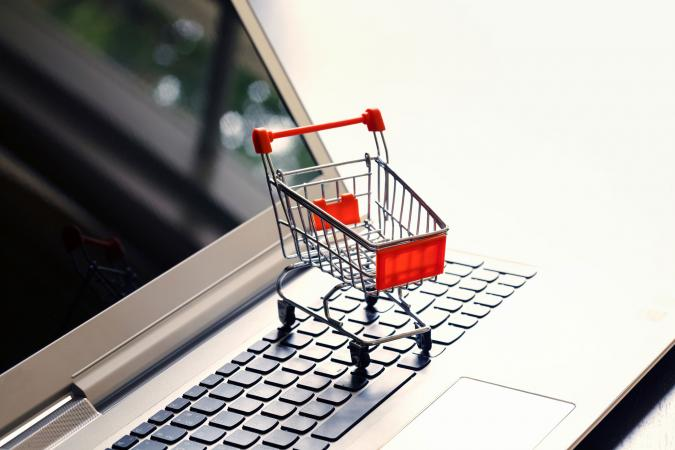 shopping cart on a computer keyboard