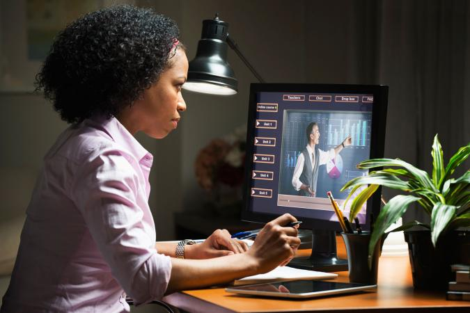 woman viewing online course