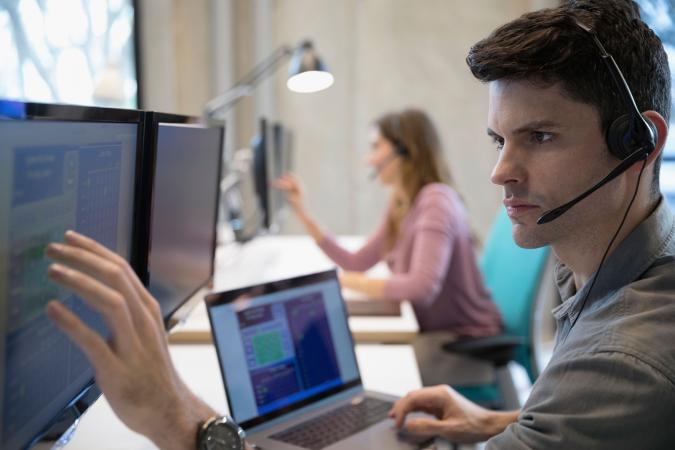 Tech person at desk with computer