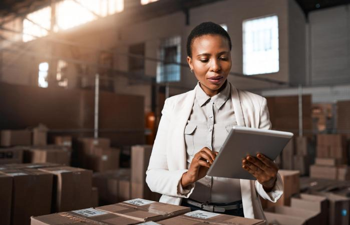 Woman using a digital tablet in a warehouse