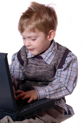 Child playing on a laptop.