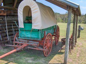 Covered wagon under a frontier lean-to
