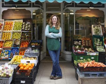 Grocer at Shop Entrance