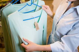 Woman shopping for organic clothing