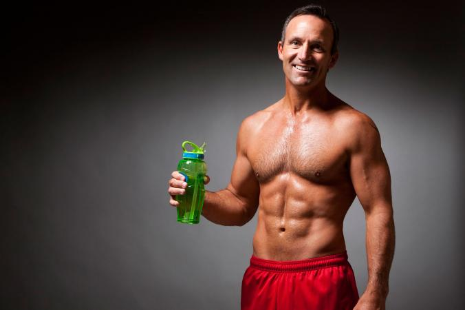 Muscle man holding water bottle