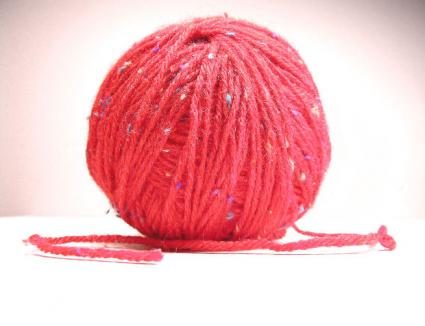 Spool of red yarn.